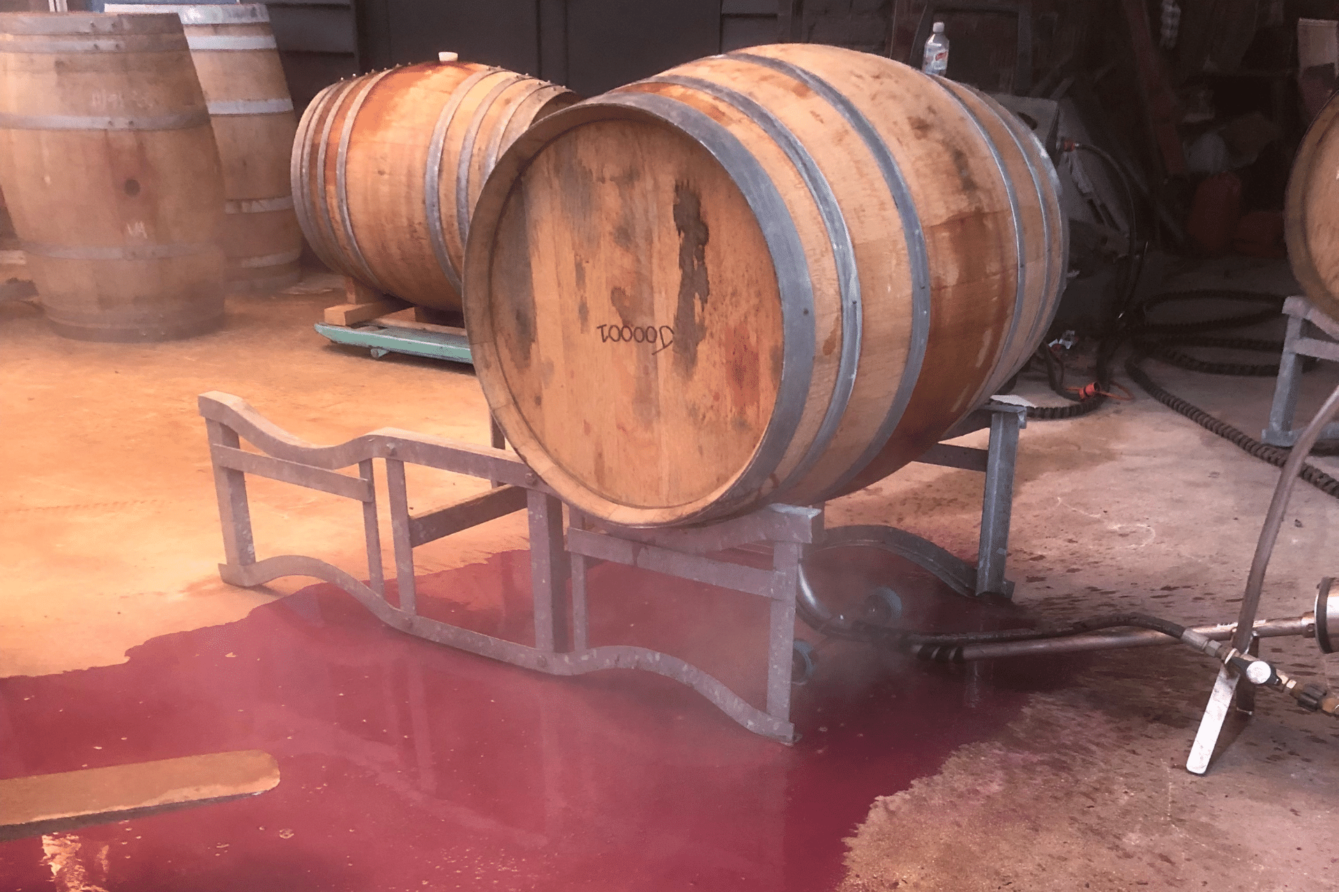 lees being flushed out of the barrel by a barrel cleaner